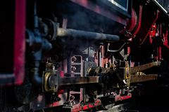 Steam train locomotive parts with oil and rust royalty free stock photography