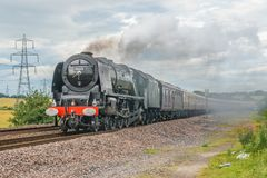 Steam train on a modern railway Stock Photos
