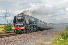 Steam train on a modern railway Stock Photos