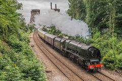 Steam train on a modern railway Royalty Free Stock Photos