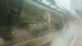 Steam Train Morning Intro. A steam train pulling off the station in London, UK stock footage
