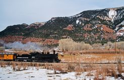Steam Train in Mountains stock photography