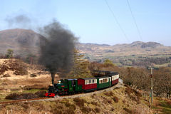 Steam Train in Mountains 8. Steam train running through the mountains on the Ffestiniog Railway, Wales, UK Royalty Free Stock Image