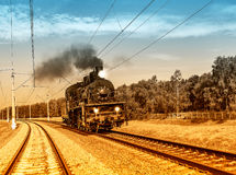 Steam train moves toward. Royalty Free Stock Images