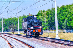 Steam train moves toward. Stock Image