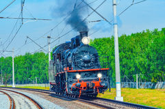 Steam train moves toward. Stock Images