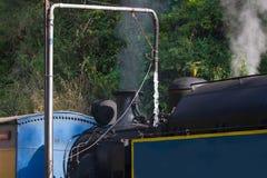 Steam train. Nilgiri mountain railway. Water refueling. Narrow-gauge. Historical locomotive. Steam train. Nilgiri mountain railway. Water refueling. India Stock Image