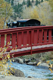 Steam Train and Old Bridge. Turn of the century steam locomotive train and old wooden bridge Stock Photos