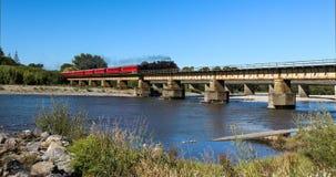 Steam Train Over River. Steam train cross over a railway bridge Stock Photography