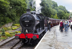Steam Train at platform at Oxenhope Railway Station on Keighley and Worth Valley Railway. Yorkshire, England, UK, Royalty Free Stock Photo
