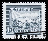 Steam Train and Postal Runner, EAST CHINA serie, circa 1949. MOSCOW, RUSSIA - MARCH 30, 2019: A stamp printed in China, People`s Republic - Regional Issues shows stock image