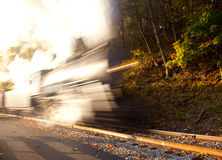 Steam train powers along railway Royalty Free Stock Photography