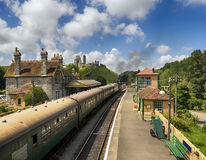 Steam Trains at Corfe Castle Station. A steam train pulls in to the station at Corfe Castle in Dorset Royalty Free Stock Photo