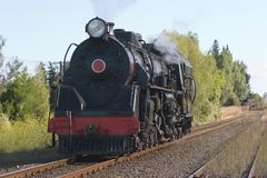 Steam train on railway line Stock Photos
