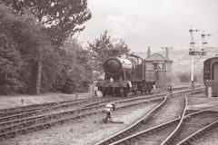 Steam Train on Railway Track. In Black and White Sepia Tone Stock Photo