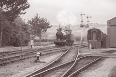 Steam Train on Railway Tracks. In Black and White Sepia Tone Stock Photography