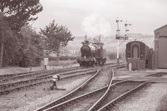 Steam Train on Railway Tracks Stock Photography