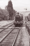 Steam Train on Railway Tracks. In Black and White Sepia Tone Stock Photos
