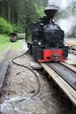 Steam train refilling with water Stock Photo