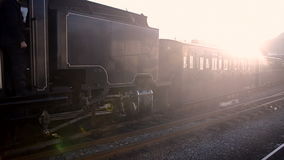 Steam train reversing into a station. A vintage steam train reversing into a station stock footage