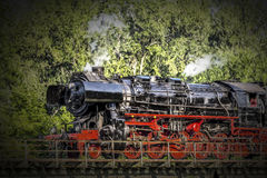 Steam train. In ride over a bridge Royalty Free Stock Images