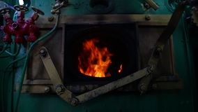Steam train`s furnace opens and closes. Retro concept stock video footage