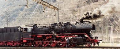 Steam train in the snow Stock Photo