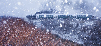Steam Train in Snow Storm. Old Steam Train in Snow Storm. Travel in extreme weather conditions Stock Photos