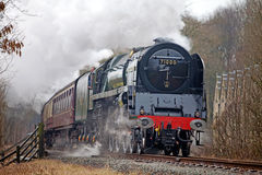 Steam train at speed Stock Photo