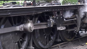 Steam train starts to move close up of wheels and steam 4K. Close up of wheels as steam train starts to move 4K stock footage