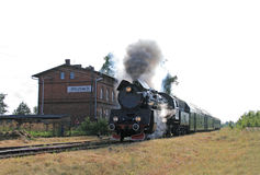 Steam train at the station Stock Photos