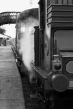Steam train at station stock image