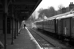 Steam train at station. Steam train with Victorian coaches and baggage car in a station royalty free stock photos