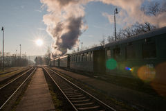 Steam train at the station on rails. Historic steam train departs from the station Stock Photo