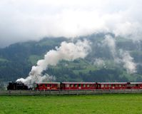 Steam train, steam and clouds Stock Photography
