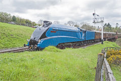 Steam train traveling through countryside Royalty Free Stock Image