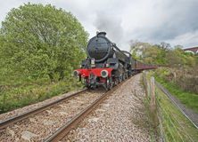 Steam train traveling through countryside Stock Image