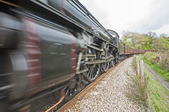 Steam train traveling through countryside Royalty Free Stock Images