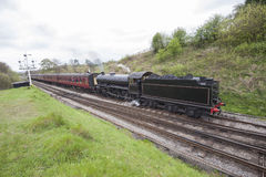 Steam train traveling through countryside Royalty Free Stock Photography