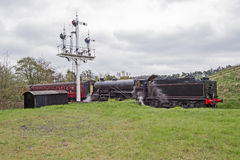 Steam train traveling through countryside Stock Photography
