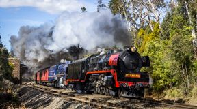 Steam Train travelling through Macedon, Victoria, Australia, September 2018. Double Header Steam Train travelling through Macedon, Victoria, Australia, September royalty free stock image
