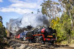Steam Train travelling through Macedon, Victoria, Australia, September 2018. Double Header Steam Train travelling through Macedon, Victoria, Australia, September royalty free stock photo