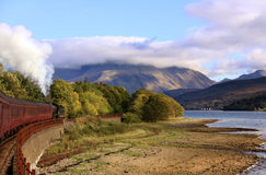 Steam train travelling towards Ben Nevis, Scotland Royalty Free Stock Photos