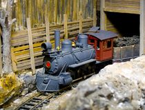 Steam Train & Tunnel. This little steam train is coming out of the tunnel Royalty Free Stock Photos