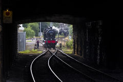 Steam Train through tunnel at Keighley Railway Station on Keighley and Worth Valley Railway. Yorkshire, England, UK, Royalty Free Stock Photography
