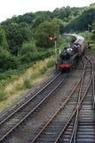 Steam train turning corner Stock Image