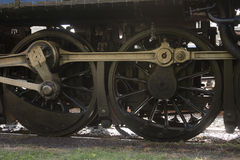 Steam Train Wheels. Close up on the wheels and gears of a steam locomotive Royalty Free Stock Image