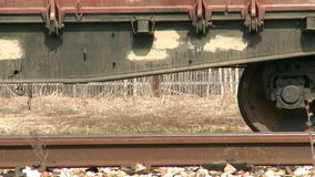 Steam train wheels. Closeup of wheels of an antique locomotive. Audio included stock footage