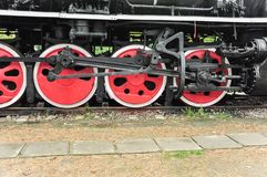 Steam train wheels in red color stock photography