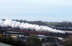Steam Trains Double Headed Black Fives, Carnforth. The Winter Cumbrian Mountain Express leaving Carnforth after a stop for water en route from Manchester Stock Photo